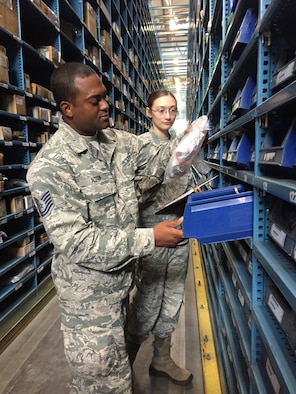 Tech. Sgt. Lucius Alston, a supply specialist from the 927th Logistics Readiness Squadron, MacDill Air Force base, Florida, works alongside his active duty counterpart Senior Airman Heather Vancamp, 52nd Logistics Readiness Squadron, Spangdahlem, Germany. Citizen Airmen from the 927 LRS, traveled to Spangdahlem Air Base, Germany, to perform their annual training, July 7-23, 2017. (U.S. Air Force photo by Tech. Sgt. Peter Dean)