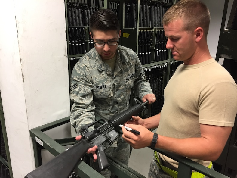 Senior Airman Thomas Crews, a supply specialist from the 927th Logistics Readiness Squadron, MacDill Air Force base, Florida, works alongside his active duty counterpart Senior Airman Daniel Padilla, 52nd Logistics Readiness Squadron, Spangdahlem, Germany. Citizen Airmen from the 927 LRS, traveled to Spangdahlem Air Base, Germany, to perform their annual training, July 7-23, 2017. (U.S. Air Force photo by Tech. Sgt. Peter Dean)