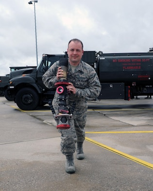 Senior Airman Brett Caske, a petroleum, oil and lubricants specialist from the 927th Logistics Readiness Squadron, MacDill Air Force base, Florida, prepares to deliver fuel. Citizen Airmen from the 927 LRS, traveled to Spangdahlem Air Base, Germany, to perform their annual training, July 7-23, 2017. (U.S. Air Force photo by Tech. Sgt. Peter Dean)
