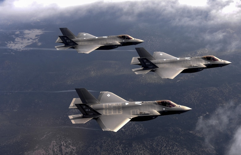 F-35 Lighting II fighter jets, assigned to the 6th Weapons Squadron, at Nellis Air Force Base, Nev., fly over the Nevada Test and Training Range July 10, 2017. The United States Air Force Weapons School teaches graduate-level instructor courses that provide the world's most advanced training in weapons and tactics employment to officers of the combat air forces and mobility air forces. (U.S. Air Force photo by Staff Sgt. Daryn Murphy/Released)