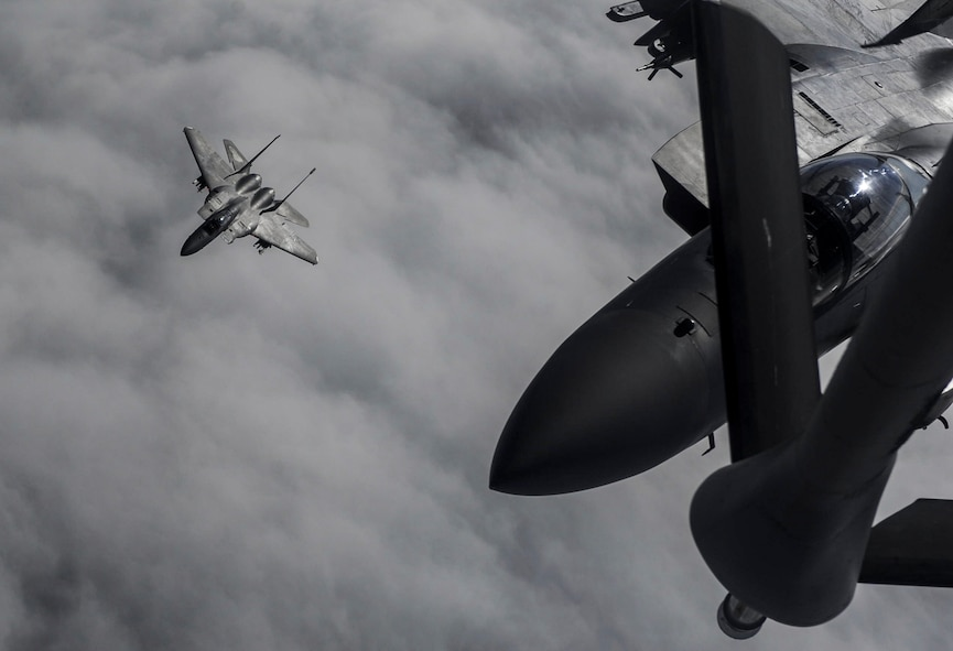 An F-15 fighter jet, assigned to the 433rd Weapons Squadron, at Nellis Air Force Base, prepares for aerial refueling over the Nevada Test and Training Range, Nev., July 10, 2017. The United States Air Force Weapons School teaches graduate-level instructor courses that provide the world's most advanced training in weapons and tactics employment to officers of the combat air forces and mobility air forces. (U.S. Air Force photo by Senior Airman Kevin Tanenbaum/Released)