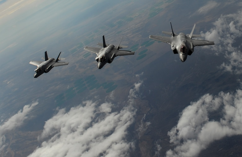 F-35 Lightning II fighter jets, assigned to the 6th Weapons Squadron, at Nellis Air Force Base, Nev., fly in formation over the Nevada Test and Training Range, Nev., July 10, 2017. The United States Air Force Weapons School teaches graduate-level instructor courses that provide the world's most advanced training in weapons and tactics employment to officers of the combat air forces and mobility air forces. (U.S. Air Force photo by Senior Airman Kevin Tanenbaum/Released)