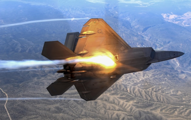 An F-22 Raptor fighter jets, assigned to the 433rd Weapons Squadron, at Nellis Air Force Base, Nevada, banks and flies over the Nevada Test and Training Range July 10, 2017. The United States Air Force Weapons School teaches graduate-level instructor courses that provide the world's most advanced training in weapons and tactics employment to officers of the combat air forces and mobility air forces. (U.S. Air Force photo by Staff Sgt. Daryn Murphy/Released)