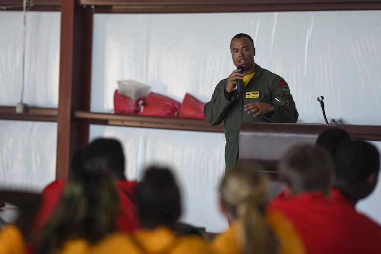 Maj. Aaron Jones, 81st Fighter Squadron AAF flight commander and Legacy Flight Academy event coordinator team member, encourages youth to explore military aviation careers during the Eyes Above the Horizon diversity outreach program, July 22, 2017, in Valdosta, Ga. The Valdosta Regional Airport welcomed approximately 100 10-19-year-olds as they took the Valdosta skies to commemorate the 76th Anniversary of the historic Tuskegee Airmen. The program focuses on mentoring and familiarizing underrepresented minorities with basic flying fundamentals. (U.S. Air Force photo by Senior Airman Greg Nash)