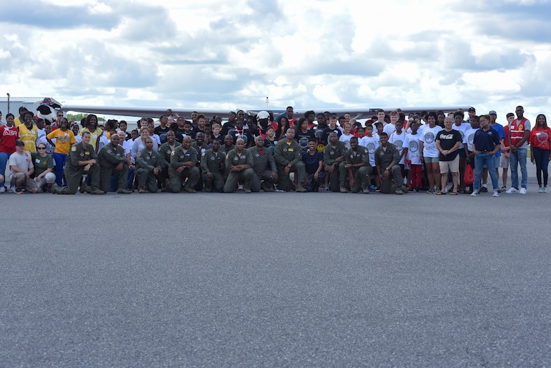 Local youth pose with collegiate advisors and Airmen during the Eyes Above the Horizon diversity outreach program, July 22, 2017, in Valdosta, Ga. Approximately 100 10-19-year-olds learned about aviation as they took the Valdosta skies to commemorate the 76th Anniversary of the historic Tuskegee Airmen. The program focuses on mentoring and familiarizing underrepresented minorities with basic flying fundamentals. (U.S. Air Force photo by Senior Airman Greg Nash)