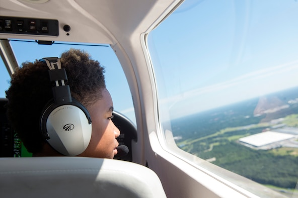 A South Georgian youth overlooks the skies as he co-pilots a Piper Archer aircraft during the Eyes Above the Horizon diversity outreach program, July 22, 2017, in Valdosta, Ga. Moody Airmen, service members nationwide and collegiate representatives taught approximately 100 10-19-year-olds about aviation as they took the Valdosta skies to commemorate the 76th Anniversary of the historic Tuskegee Airmen. The program focuses on mentoring and familiarizing underrepresented minorities with basic flying fundamentals. (U.S. Air Force photo by Senior Airman Greg Nash)