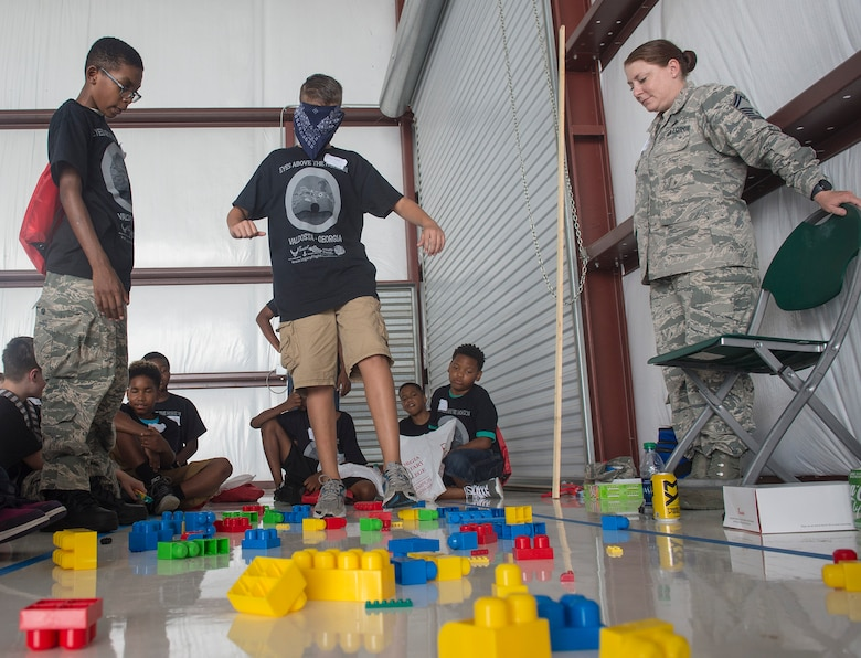 Youth participate in a team-building exercise as a part of the Eyes Above the Horizon diversity outreach program, July 22, 2017, in Valdosta, Ga. The Valdosta Regional Airport welcomed approximately 100 10-19-year-olds as they took the Valdosta skies to commemorate the 76th Anniversary of the historic Tuskegee Airmen. The program focuses on mentoring and familiarizing underrepresented minorities with basic flying fundamentals. (U.S. Air Force photo by Senior Airman Greg Nash)