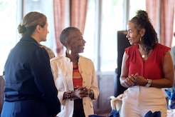 (Left to right) Col. Mary Teeter, 89th Maintenance Group commander, Jacqueline Woody, Prince George's County chief of staff senior advisor and Sandra Longs-Hasty, Prince Georges County chief information officer have a conversation prior to the Joint Base Andrews 2017 Honorary Commander Immersion and Breakfast, July 25, 2017, at JBA, Md. The JBA Honorary Commander Program, which began in 1999, matches a civic leader with a military leader to provide commanders a means to educate participants about the armed forces and their various missions. (U.S. Air Force photo by Senior Airman Delano Scott)