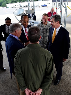 North Carolina Governor Roy Cooper and other state officials discuss the relationship shared between North Carolina and the 4th Fighter Wing, July 19, 2017, at Seymour Johnson Air Force Base, North Carolina. During his visit, Cooper spoke with base leadership and Airmen to get a better understanding of the 4th FW mission and the critical role it plays in providing Combatant Commanders dominant Strike Eagle airpower. (U.S. Air Force photo by Airman 1st Class Kenneth Boyton)