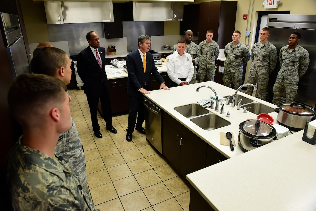North Carolina Governor Roy Cooper addresses Airmen from the 4th Civil Engineer Squadron fire department before a luncheon, July 19, 2017, at Seymour Johnson Air Force Base, North Carolina. During the luncheon, Sean Quinby, 4th CES fire chief, met with Cooper and discussed the fire department's mission and recent achievements, which include firefighters' heroic actions during Hurricane Matthew. (U.S. Air Force photo by Airman 1st Class Kenneth Boyton)