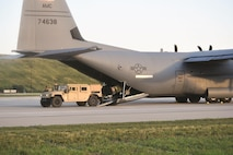 A tactical air traffic control system is loaded onto an aircraft during a joint mobility exercise June 10 through 13 involving Soldiers from D and F Companies, 2nd General Support Aviation Battalion, 1st Aviation Regiment, 1st Combat Aviation Brigade, 1st Infantry Division, and Airmen of the 61st Airlift Squadron, Little Rock Air Force Base, Arkansas.