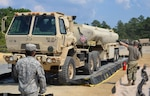 Soldiers with the 947th Quartermaster Company, Chambersburg, PA, receive a fuel truck at a fuel system supply point July 19, 2017, at Joint Base McGuire-Dix-Lakehurst, N.J., during a Quartermaster Liquid Logistic Exercise. The exercise tested the Soldiers capability to safely and efficiently receive incoming fuel trucks and download thousands of gallons fuel. Once the fuel was received, the Soldiers cleaned and recirculated it before refilling trucks awaiting resupply.
