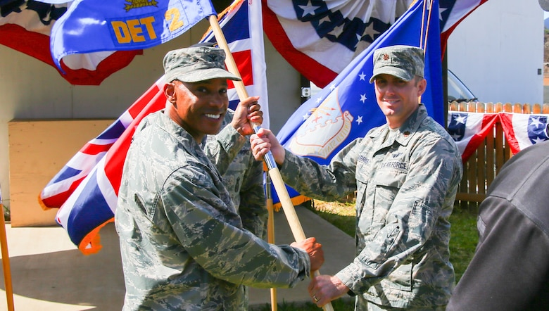 Col Kevin Williams, 45th Mission Support group commander, presents Maj Adam Harris, 45th Detachment 2 commander, with the guidon during an assumption of command ceremony July 25th, 2017, on Ascension Island. Maj Harris has previously served under the Wing's Detachment 3 as the Orion Flight Division Chief and previously as the Wing's Director of Staff. (U.S. Air Force photo)
