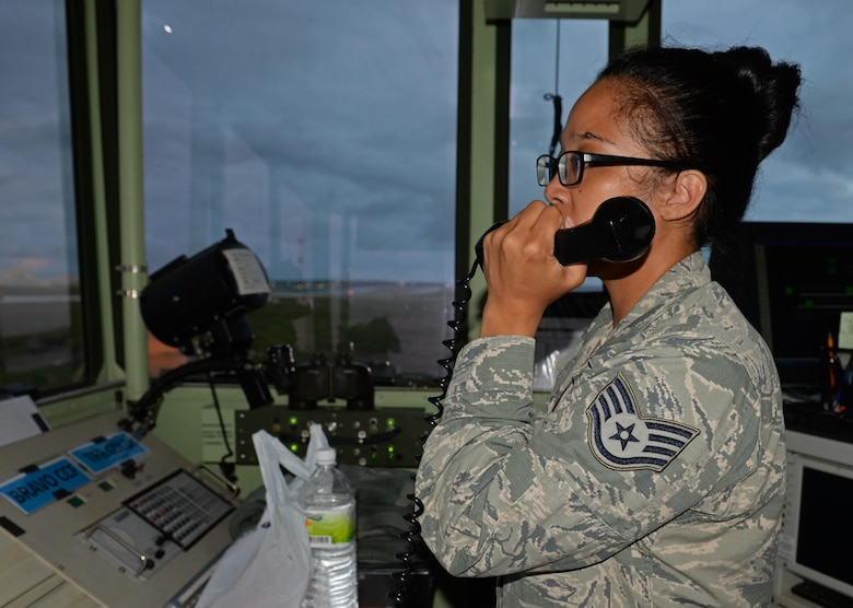 U.S. Air Force Staff Sgt. Tiffany Degracia, 36th Operation Support Squadron air traffic controller communicates via radio with pilots preparing to take off June 20, 2017, at Andersen Air Force Base, Guam. Air traffic control Airmen assigned to the 36th Operation Support Squadron began work in the new tower cab here June 30 after spending almost three months working in the mobile tower unit on the flightline. (U.S. Air Force photo by Senior Airman Alexa Ann Henderson)