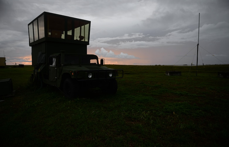 The sun rises behind an MSN-7 mobile control tower parked on the flightline June 20, 2017, at Andersen Air Force Base, Guam. Air traffic control Airmen assigned to the 36th Operation Support Squadron began work in the new tower cab here June 30 after spending almost three months working in the mobile tower unit on the flightline. (U.S. Air Force photo by Senior Airman Alexa Ann Henderson)