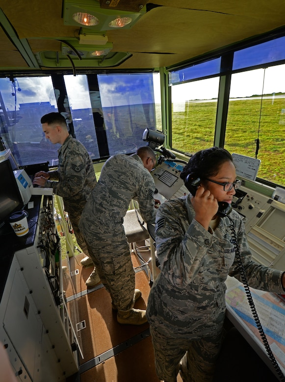 U.S. Air Force Airmen assigned to the 36th Operation Support Squadron work in the MSN-7 mobile tower unit parked on the flightline June 22, 2017, at Andersen Air Force Base, Guam. Air traffic control Airmen assigned to the 36th Operation Support Squadron began work in the new tower cab here June 30 after spending almost three months working in the mobile tower unit on the flightline. (U.S. Air Force photo by Senior Airman Alexa Ann Henderson)