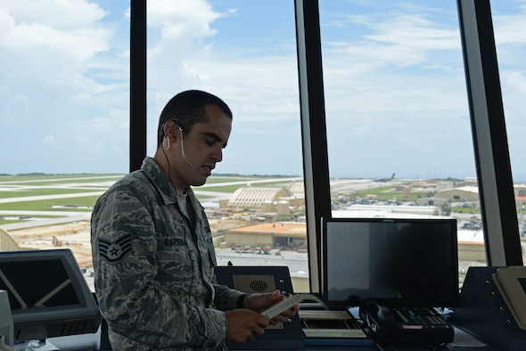 U.S. Air Force Staff Sgt. Nicholas Barsenas, 36th Operation Support Squadron air traffic controller, speaks with pilots on July 17, 2017, at Andersen Air Force Base, Guam. Air traffic control Airmen assigned to the 36th Operation Support Squadron began work in the new tower cab here June 30 after spending almost three months working in the mobile tower unit on the flightline. (U.S. Air Force photo by Airman 1st Class Gerald Willis)