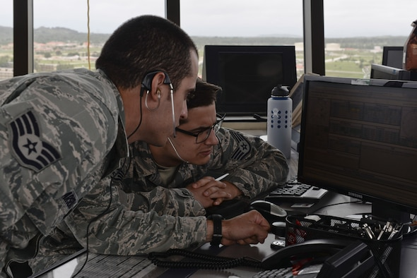 U.S. Air Force Staff Sgt. Nicholas Barsenas, 36th Operation Support Squadron air traffic controller (left), and Staff Sgt. Nicholas Luciano, review flight information inside the updated tower July 17, 2017, at Andersen Air Force Base, Guam. Air traffic control Airmen assigned to the 36th Operation Support Squadron began work in the new tower cab here June 30 after spending almost three months working in the mobile tower unit on the flightline. (U.S. Air Force photo by Airman 1st Class Gerald Willis)
