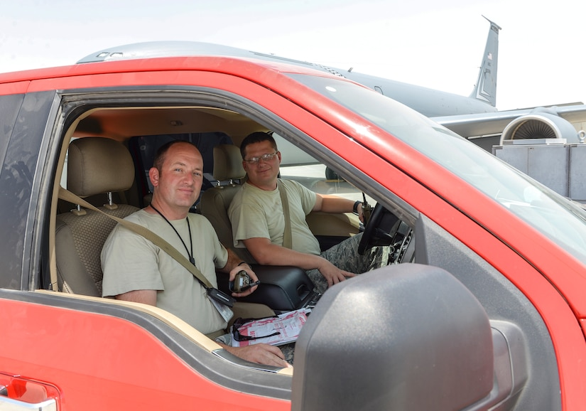 U.S. Air Force Senior Master Sgts. Ian Catania, foreground, assigned to the 22nd Expeditionary Aircraft Maintenance Unit, and William Sams, driver's seat, assigned to the 340th Expeditionary Aircraft Maintenance Unit, are production superintendents responsible for keeping all tanker flights on schedule at Al Udeid, Air Base, Qatar, July 7, 2017. The members of the 340th and 22nd EAMUs face minute-by-minute challenges in the sweltering heat on the runway as they work to keep a fleet of KC-135 Stratotankers ready to fly. (U.S. Air National Guard photo by Tech. Sgt. Bradly A. Schneider/Released)