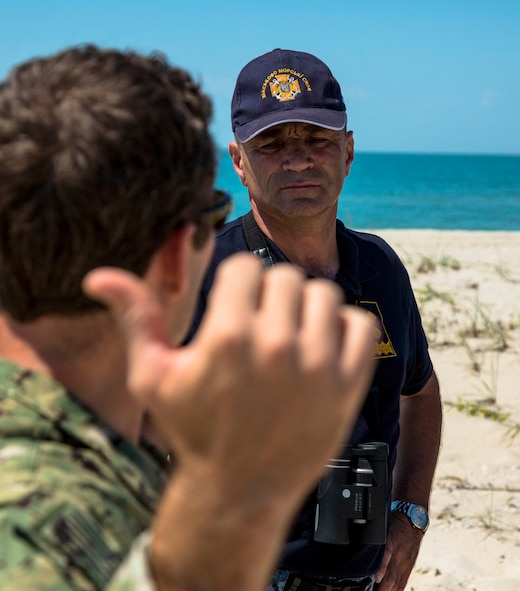 A U.S. Naval Special Warfare Command operator briefs Vice Adm. Ihor Voronchenko, commander of the Ukrainian navy on Tendra Island, Ukraine, at exercise Sea Breeze 17, July 19, 2017. Special Operations Command Europe photo by Army Spc. Jeffery Lopez