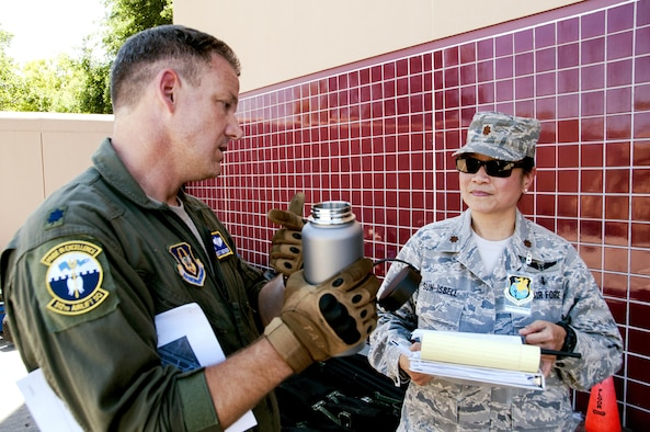 Lt. Col. Scott Shepard, 349th Aeromedical Staging Squadron flight surgeon, is interviewed by Maj. Theresa Sun-Isbell, 349th ASTS wing inspection team lead, as part of a unit evaluation for Patriot Wyvern at Travis Air Force, Calif., July 22, 2017. The 349th ASTS members had one hour to set up the En-Route Patient Staging Facility and communications. They accomplished their task in 35 minutes. (U.S. Air Force photo by Staff Sgt. Daniel Phelps)