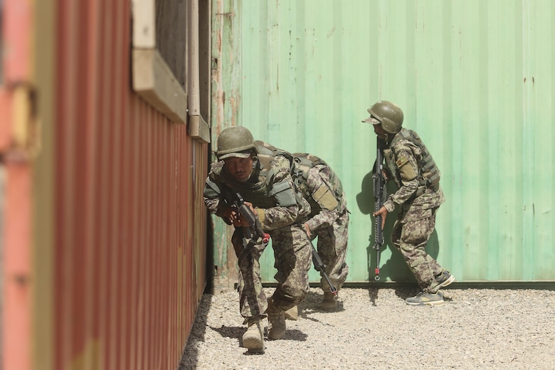 Afghan National Army soldiers with 2nd Kandak, 4th Brigade, 215th Corps conduct military operations in urban terrain training at Camp Shorabak, Afghanistan, July 7, 2017. Approximately 600 soldiers with the unit graduated from an eight-week operational readiness cycle July 24 with assistance from U.S. Marines assigned to Task Force Southwest. The ORC is designed to bolster its students' warfighting capabilities as a means to defeat insurgency and enhance security throughout the region. (U.S. Marine Corps photo by Sgt. Lucas Hopkins)