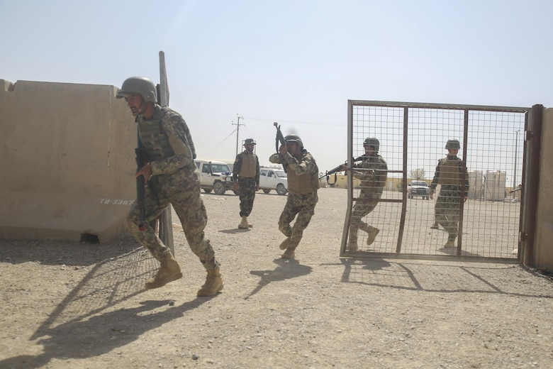 Afghan National Army soldiers with 3nd Kandak, 4th Brigade, 215th Corps prepare to clear a room during military operations in urban terrain training at Camp Shorabak, Afghanistan, July 5, 2017. Approximately 15 Marine advisors assisted their Afghan counterparts throughout an operational readiness cycle, an eight-week training program teaching soldiers infantry skills and weapons techniques in order to thwart enemy presence in Helmand Province. (U.S. Marine Corps photo by Sgt. Lucas Hopkins)
