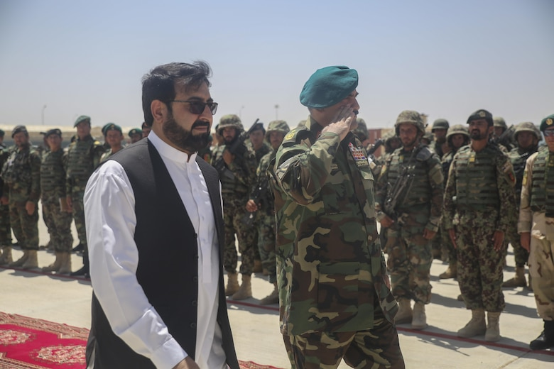 Hayatullah Hayat, left, the governor of Helmand Province, and Afghan National Army Brig. Gen. Wali Mohammed Ahmadzai, right, the commanding general of 215th Corps, greet soldiers with 2nd Kandak, 4th Brigade, 215th Corps during a graduation ceremony at Camp Shorabak, Afghanistan, July 24, 2017. Approximately 600 soldiers with the unit graduated from an eight-week operational readiness cycle July 24 with assistance from U.S. Marines assigned to Task Force Southwest. The ORC is designed to enhance the students' warfighting capabilities to help defeat insurgency throughout the region. (U.S. Marine Corps photo by Sgt. Lucas Hopkins)
