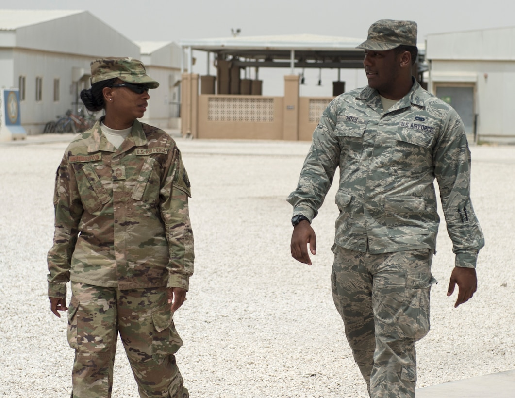 U.S. Air Force Senior Airman Quae Hayes, right, an analyst with the 379th Expeditionary Maintenance Group, talks with Chief Master Sgt. Gloria Weatherspoon, a chief enlisted manager with the 379th Expeditionary Forces Support Squadron at Al Udeid Air Base, Qatar, July 14, 2017.  Hayes is taking part in a Chief Shadowing Program and was paired up with Chief Master Sgt. Gloria Weatherspoon, right, a chief enlisted manager with the 379th EFSS, for the day in order to receive a glimpse into the day-to-day actives of a Chief Master Sgt. in the U.S. Air Force. (U.S. Air Force photo by Tech. Sgt. Amy M. Lovgren)