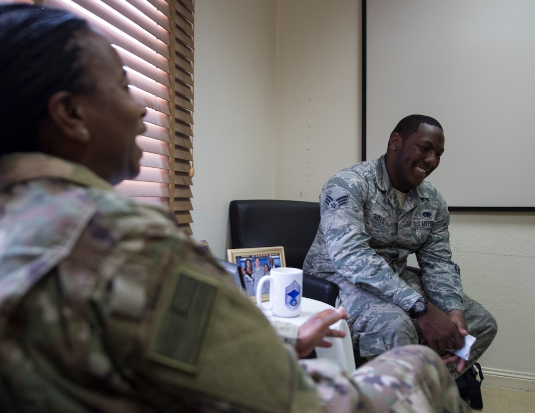 U.S. Air Force Senior Airman Quae Hayes, right, an analyst with the 379th Expeditionary Maintenance Group, ask questions of Chief Master Sgt. Gloria Weatherspoon, a chief enlisted manager with the 379th Expeditionary Forces Support Squadron at Al Udeid Air Base, Qatar, July 14, 2017.  Hayes is taking part in a Chief Shadowing Program and was paired up with Chief Master Sgt. Gloria Weatherspoon, right, a chief enlisted manager with the 379th EFSS, for the day in order to receive a glimpse into the day-to-day actives of a Chief Master Sgt. in the U.S. Air Force. (U.S. Air Force photo by Tech. Sgt. Amy M. Lovgren)
