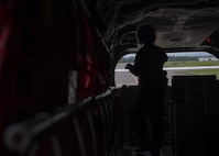 A Japan Air Self-Defense Force CH-47J crew chief assigned to the Air Reserve Wing, Flight Group Misawa Helicopter Airlift Squadron, conducts post-flight procedures upon arriving at Chitose Air Base, Japan, July 21, 2017. The ARW is located at JASDF Iruma Air Base, Japan, near the north of western Tokyo. The CH-47J was providing cargo to Chitose AB, which gave Pacific Air Forces' F-16 Demonstration Team members the opportunity to use this method of transportation. (U.S. Air Force Staff Sgt. Deana Heitzman)