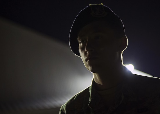 U.S. Air Force Senior Airmen Brandon Rains, a 35th Security Forces Squadron base defense operations controller, stands guard during a night shift at Chitose Air Base, Japan, July 23, 2017. Due to being isolated on a foreign runway, U.S. personnel must have eyesight on the Pacific Air Forces' F-16 Demonstration Team F-16 Fight Falcons at all times. If anything were to occur, 35th SFS personnel would work with Japan Air Self-Defense Force base operations and security personnel to ensure proper safety measures were completed. (U.S. Air Force Staff Sgt. Deana Heitzman)
