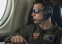U.S. Navy Petty Officer 2nd Class Morgan Reeves, Naval Air Facility Misawa crewman, looks out the window of a UC-12F Huron during a flight back to Misawa Air Base, Japan, July 24, 2017. In the past, Reeves and his team have transported the Pacific Air Forces' F-16 Demonstration Team to other U.S. and foreign military bases in Japan and the Republic of Korea. (U.S. Air Force Staff Sgt. Deana Heitzman)