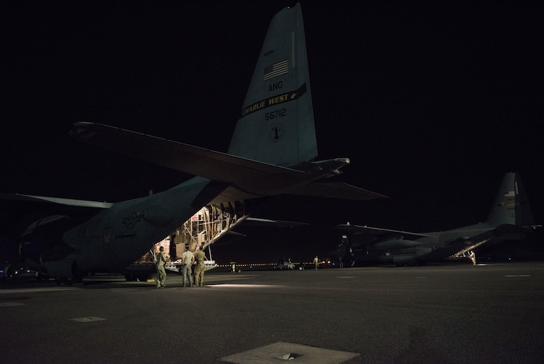 C-130H Hercules aircraft deployed from the 130th Airlift Wing of Charleston, West Virginia and the 133rd Airlift Wing of St. Paul, Minnesota sit on the flightline prior to departing on a combat mission at an undisclosed location in Southwest Asia, July 14, 2017. Air National Guardsmen and their aircraft, deployed in support of Combined Joint Task Force – Operation Inherent Resolve, execute daily airlift missions out of one of the busiest air bases in the U.S. Air Forces Central Command area of responsibility. (U.S. Air Force photo by Tech. Sgt.  Jonathan Hehnly)
