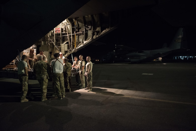 An aircrew assigned to the 737th Expeditionary Airlift Squadron holds a pre-flight brief at the rear of a C-130H Hercules prior to departing on a combat mission at an undisclosed location in Southwest Asia, July 14, 2017. Air National Guardsmen and their aircraft, deployed in support of Combined Joint Task Force – Operation Inherent Resolve, execute daily airlift missions out of one of the busiest air bases in the U.S. Air Forces Central Command area of responsibility. (U.S. Air Force photo by Tech. Sgt.  Jonathan Hehnly)