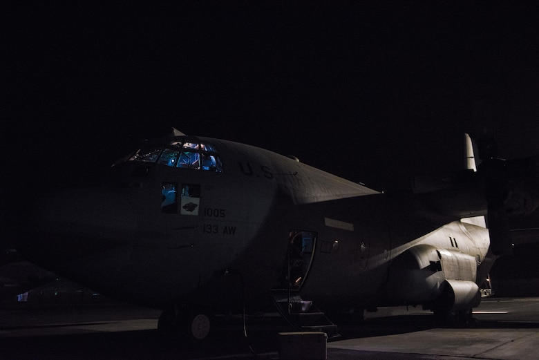 Pilots with the 737th Expeditionary Airlift Squadron conduct pre-flight checks in the cockpit of a C-130H Hercules before performing a combat mission at an undisclosed location in Southwest Asia, July 14, 2017. Air National Guardsmen and their aircraft, deployed in support of Combined Joint Task Force – Operation Inherent Resolve, execute daily airlift missions out of one of the busiest air bases in the U.S. Air Forces Central Command area of responsibility. (U.S. Air Force photo by Tech. Sgt.  Jonathan Hehnly)