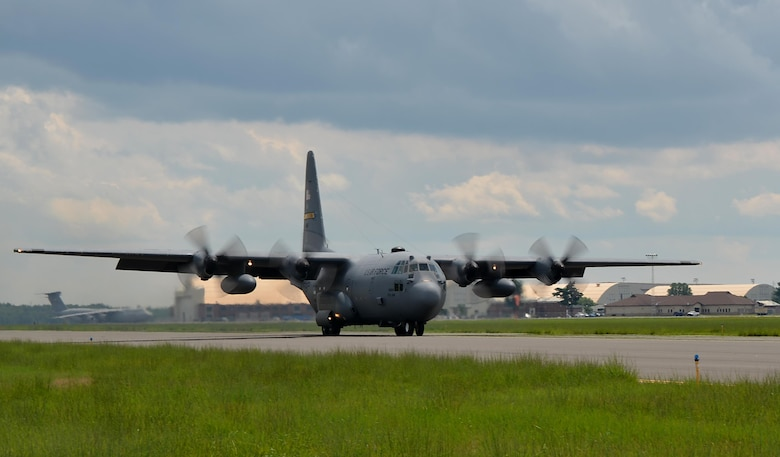A C-130 Hercules from the 103rd Airlift Wing, East Granby, taxis down the runway to perform a combat-style offload July 11, at the dog patch.