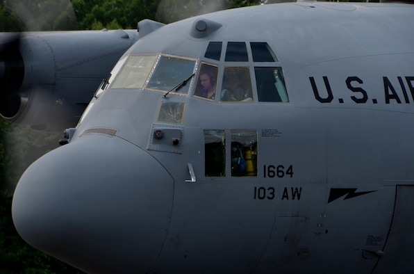 A pilot assigned to the 103rd Airlift Wing, East Granby, Conn., prepares to taxi back to the runway for takeoff July 11, at the Dogpatch. 103rd AW aircrew frequently come to Westover to practice air drops and will begin to practice combat offloads more often.