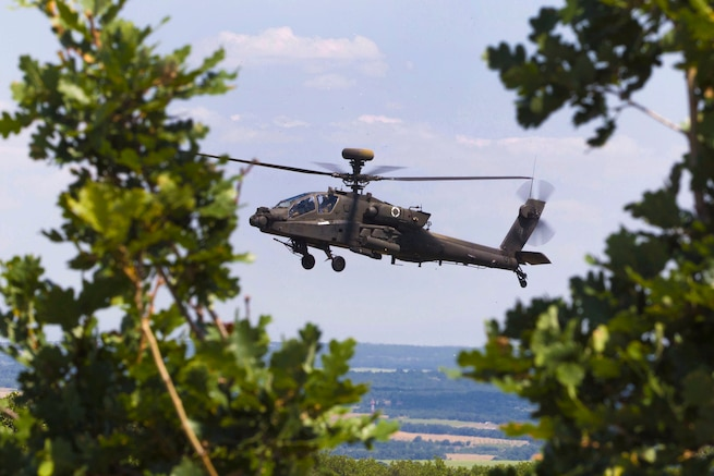 An AH-64 Apache helicopter flies towards an objective during a combined live-fire exercise Peace Sentinel in Koren, Bulgaria, July 19, 2017. The exercise is part of the Saber Guardian 17 exercise.