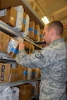 U.S. Air Force Staff Sgt. Douglas Eaton, 100th Communications Squadron Post Office postal clerk, scans a package during training on the new parcel tracking system July 18, 2017, on RAF Mildenhall, England. The new system, scheduled to take effect Aug. 14, will allow email notifications to be sent to customers when their packages have arrived at the post office. (U.S. Air Force photo by Tech. Sgt. Lauren Gleason)