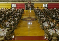 Marines watch a short video depicting the history of 1st Battalion, 6th Marine Regiment at Camp Lejeune, N.C., July 21, 2017. Marines celebrated their unit's 100-year anniversary with a rededication ceremony, dinner and a night of shared camaraderie. (U.S. Marine Corps photo by Lance Cpl. Leynard Kyle Plazo)