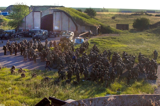 U.S., Greek and Canadian troops await the arrival of UH-60 Black Hawk helicopters before participating in air assault training during the Swift Response exercise at Bezmer Air Base, Bulgaria, July 21, 2017. The exercise is part of Saber Guardian 17. Army photo by Spc. Thomas Scaggs