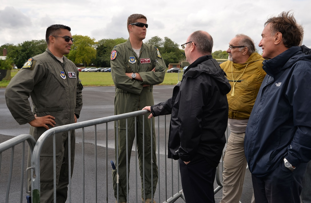 U.S. Air Force Staff Sgt. Ernesto Riojas, left, 100th Aircraft Maintenance Squadron flying crew chief, and U.S. Air Force Capt. Ben Martin, 100th Operations Group KC-135 Stratotankerpilot, talk to members of the crowd at the RAF Marham Friends and Families Day event July 20, 2017, at Marham, England. Team Mildenhall supported the event with static displays of a KC-135 Stratotanker and a CV-22 Osprey. (U.S. Air Force photo by Karen Abeyasekere)
