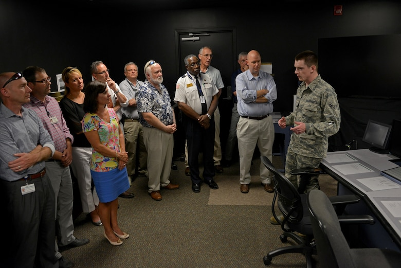 McLeod Physician Leadership Academy members listen to a brief about air traffic controller training during a base tour at Shaw Air Force Base, S.C., July 21, 2017. Airmen from the air traffic control tower and the weapons standardization flight provided information about their jobs and their training to the physicians during the tour. (U.S. Air Force photo by Airman 1st Class Destinee Sweeney)