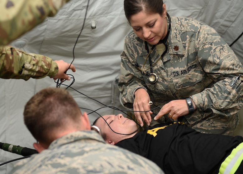 Maj. Tonja Winekauf, a nurse practioner, attends to a patient during a joint training exercise July 24, 2017, at Camp Dodge in Johnston, Iowa. Medics from the Iowa Air and Army National Guard as well as Kosovo and the United Kingdom gathered for the two-week exercise. (U.S. Air National Guard photo by Staff Sgt. Michael J. Kelly)
