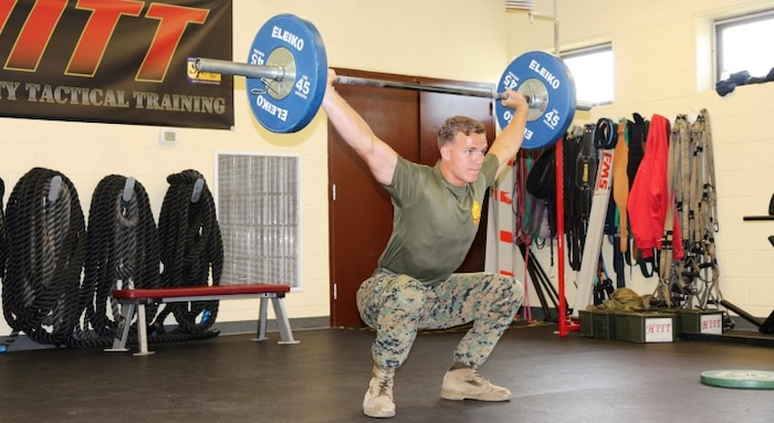 Sgt. Justin Odom, Marine Corps Systems Command training non-commissioned officer, performs a snatch lift July 18, at the High Intensity Tactical Training facility aboard Marine Corps Base Quantico, Virginia. After earning the top male competitor spot in the HITT preliminaries at Quantico, Odom was selected to represent the base in the Third Annual HITT Athlete Championship at Camp Pendleton, California, in August. (U.S. Marine Corps photo by Kaitlin Kelly)