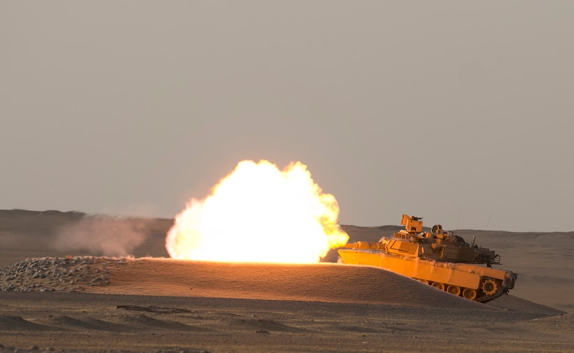 An M1A2 Abrams Main Battle Tank crew engages targets while providing direct fire support for a reconnaissance element during Hunter-Killer training at the Kuwait Multipurpose Range Complex June 7. Saber Squadron is developing Hunter-Killer as a concept, teaming Bradleys up with tanks for increased firepower and speed in the reconnaissance mission. (U.S. Army photo by Staff Sgt. Leah R. Kilpatrick/ released)