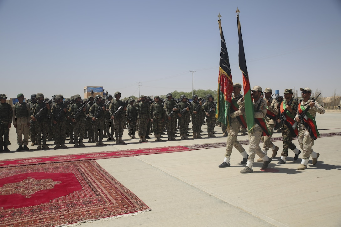 The Afghan National Army 215th Corps color guard marches the Afghan national colors during a graduation ceremony at Camp Shorabak, Afghanistan, July 24, 2017.  Approximately 600 soldiers with 2nd Kandak, 4th Brigade, 215th Corps completed an eight-week operational readiness cycle at the Helmand Province Regional Military Training Center with assistance from U.S. Marine advisors assigned to Task Force Southwest. Throughout the course, the soldiers learned infantry tactics and weapons techniques in order to enhance their warfighting capabilities. (U.S. Marine Corps photo by Sgt. Lucas Hopkins)