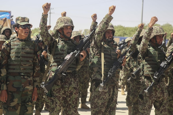 Afghan National Army soldiers with 2nd Kandak, 4th Brigade, 215th Corps chant their unit's battle song during a graduation ceremony at Camp Shorabak, Afghanistan, July 24, 2017. Hundreds of soldiers completed an operational readiness cycle at the Helmand Province Regional Military Training Center, an eight-week course designed to enhance its students' infantry and warfighting capabilities. (U.S. Marine Corps photo by Sgt. Lucas Hopkins)