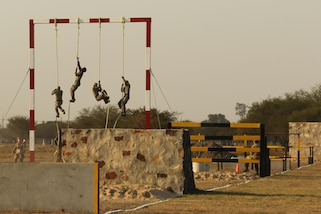 Jamaican competitors ascend ropes during an obstacle course for Fuerzas Comando on July 24, 2017, in Vista Alegre, Paraguay. Nations competing in Fuerzas Comando refine the tactics used by their special operations forces. By increasing their special operations capabilities, countries become more proficient at confronting common threats. (U.S. Army photo by Sgt. Joanna Bradshaw/Released)